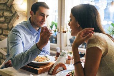 Couple having dinner in a restaurant - MOMF00105