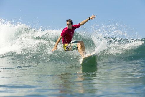 Indonesia, Bali, man surfing - KNTF00823