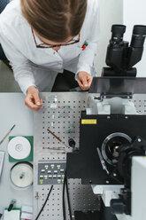 Laboratory technician working in modern lab - ZEDF00585