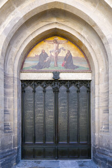 Germany, Lutherstadt Wittenberg, entrance gate of castle church with Luther's ninety-five theses - KLR00519