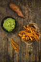 Sweet potato fries and avocado dip on wood - LVF06020