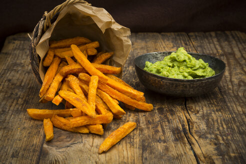 Sweet potato fries and avocado dip on wood - LVF06023