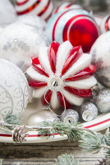 Christmas baubles on plate, close-up - LVF06029