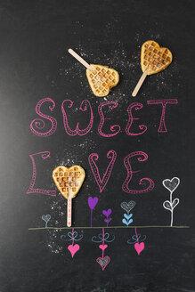 Heart-shaped waffles on painted blackboard - MYF01904