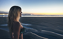 Young woman watching the sunset on the beach - DAPF00691