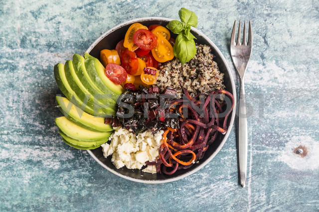 Lunch bowl of quinoa tricolore, chard, avocado, carrot spaghetti, tomatoes and feta - SARF03287