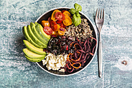 Lunch bowl of quinoa tricolore, chard, avocado, carrot spaghetti, tomatoes and feta - SARF03287