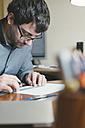 Architect drafting at desk - SKCF00284