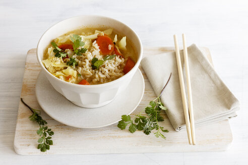 Bowl of Asian soup with white cabbage, carrots and rice - EVGF03210