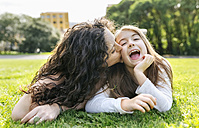 Mother and daughter having fun lying in the grass - MGOF03223