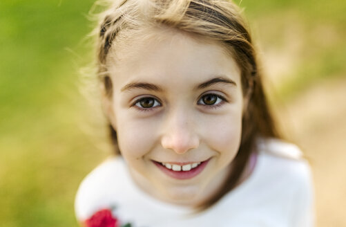 Portrait of a smiling girl outdoors - MGOF03229
