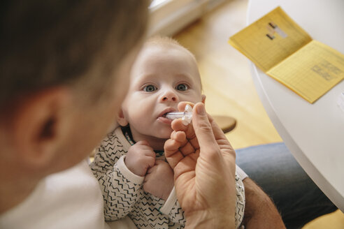 Three-month-old baby receiving oral vaccination - MFF03482
