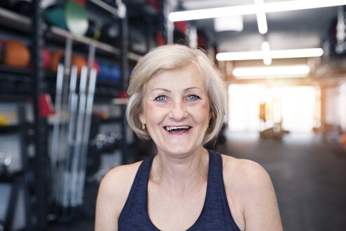 Portrait of happy senior woman in gym - HAPF01449