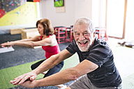 Senior man and woman exercising in gym - HAPF01458