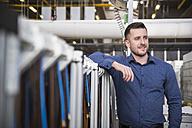 Portrait of confident businessman in factory shop floor - DIGF01841