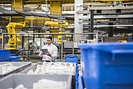 Man using tablet in factory shop floor - DIGF01865