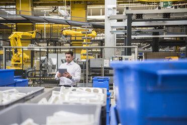 Man using tablet in factory shop floor - DIGF01865