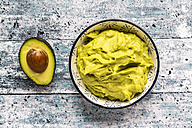 Bowl of avocado hummus and half of avocado - SARF03307