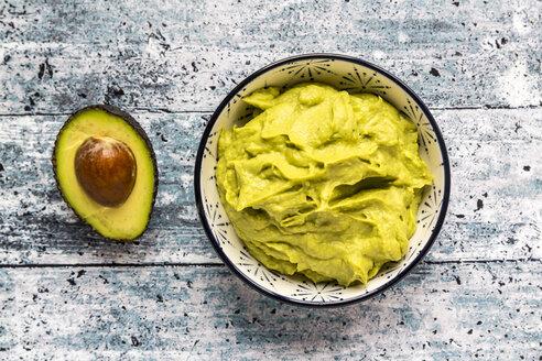 Bowl of avocado hummus and half of avocado - SARF03307