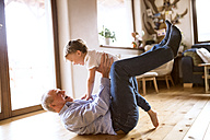Grandfather and grandson having fun  at home - HAPF01500