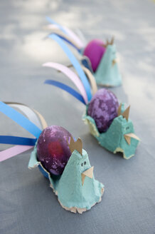 Easter decoration with dyed eggs and self-made egg cups - GISF00283
