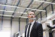 Serious businessman in factory shop floor - DIGF02049