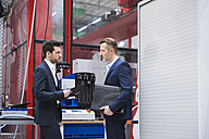 Two businessmen in factory shop floor - DIGF02067