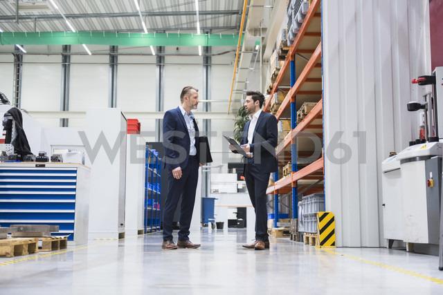Two businessmen in factory shop floor - DIGF02070