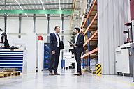 Two businessmen in factory shop floor - DIGF02070