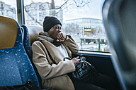 Yawning young woman traveling by bus - KIJF01410