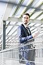 Businessman standing on parking level, portrait - UUF10357