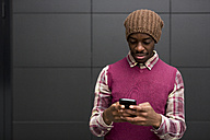 Portrait of man looking at cell phone - MAUF01058