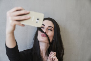 Young woman pouting taking a selfie - FMKF03976