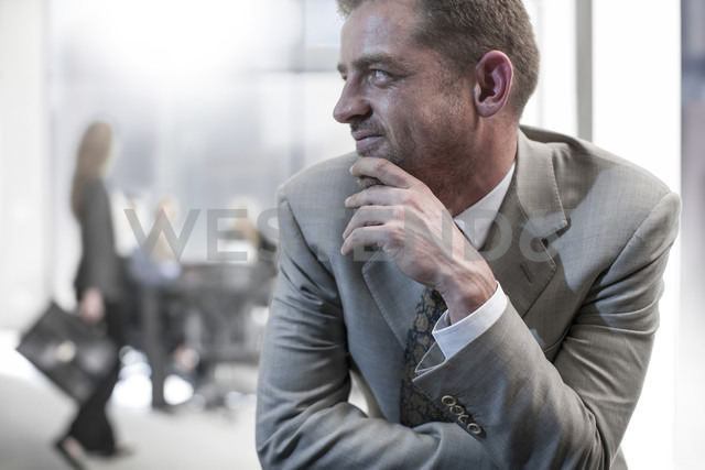 Smiling businessman in office - ZEF13602