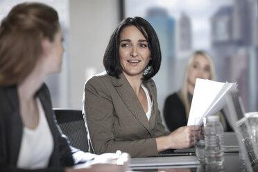 Two women talking in boardroom meeting - ZEF13605