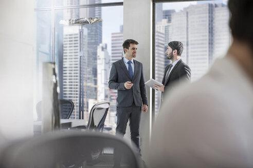 Two businessmen talking in city office - ZEF13611