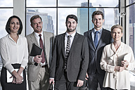 Portrait of confident businessmen and businesswomen in office - ZEF13614