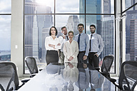 Portrait of confident businessmen and businesswomen in conference room - ZEF13617