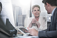 Smiling businesswoman in office meeting - ZEF13635