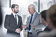 Two businessmen talking in city office - ZEF13638