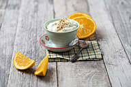 Bowl of orange curd creme with popped quinoa - MYF01911