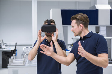 Two men in testing instrument room with VR glasses - DIGF02153