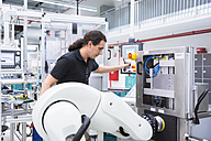 Man with assembly robot in factory - DIGF02230
