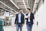 Two men with tablet talking in factory shop floor - DIGF02260