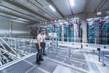 Two men in automatized high rack warehouse - DIGF02334