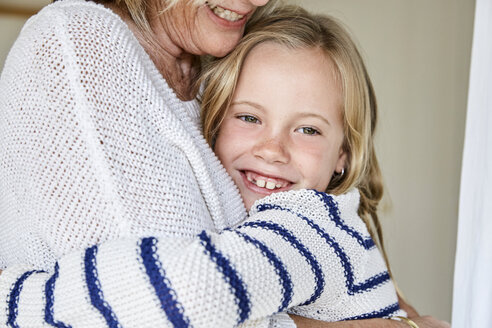Portrait of happy little girl hugging her grandmother - SRYF00289