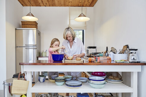 Grandmother and granddaughter preparing food in the kitchen - SRYF00298