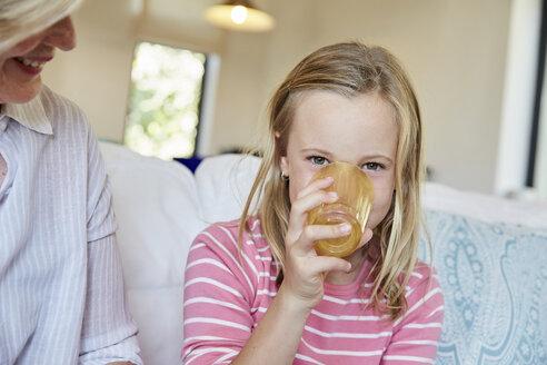 Portrait of little girl drinking - SRYF00301