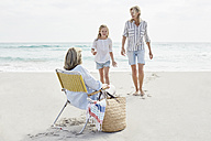 Mother daughter and grandma spending a day on he beach - SRYF00355