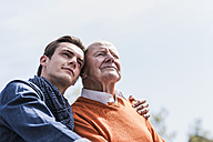 Senior man and adult grandson outdoors - UUF10455